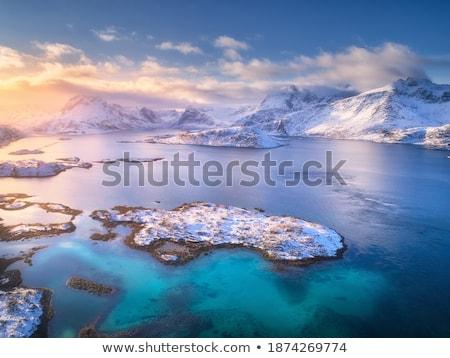 snowy sunlight rocks in evening stock photo © bsani