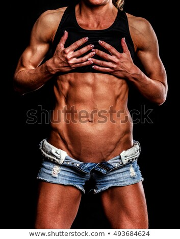 Fuerte mujer posando deportes sujetador shorts Foto stock © wavebreak_media