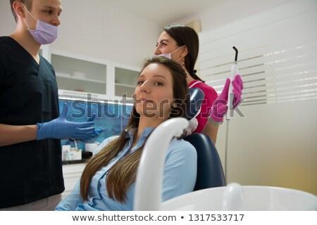 dentista · máscara · cirúrgica · dental · explorador · clínica - foto stock © wavebreak_media
