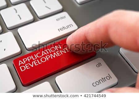 Finger Presses Red Keyboard Button Application Development. Stock photo © tashatuvango