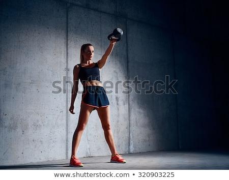 Beautiful athlete doing kettlebell swings Stock photo © bezikus
