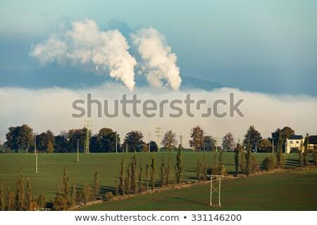 Palenia fabryki ukryty mgły rano Zdjęcia stock © artush