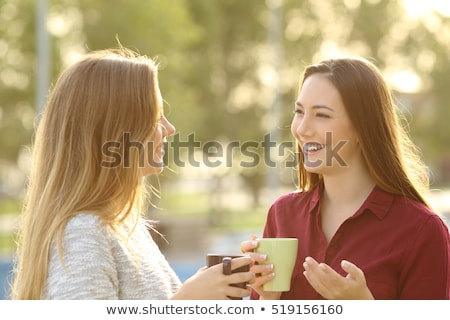 two young woman relaxing chatting at home stock photo © dash