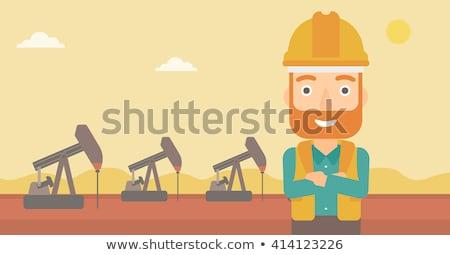 pracownik · olej · uniform · kask · stałego · broni - zdjęcia stock © rastudio