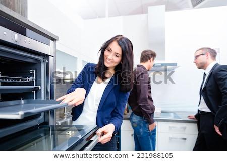 Pareja · consultar · vendedor · nacional · cocina · hombre - foto stock © kzenon