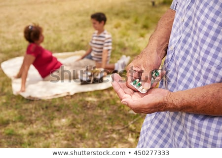 Old Man Grandpa With Family Taking Medicine Pill For Heart Stock photo © diego_cervo