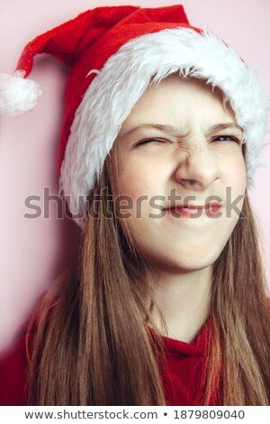 Close up portrait of beautiful blond girl in Santa Claus Hat stock photo © dash