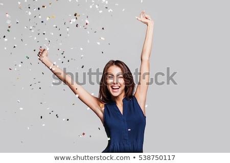 girl celebrates in studio stock photo © bezikus