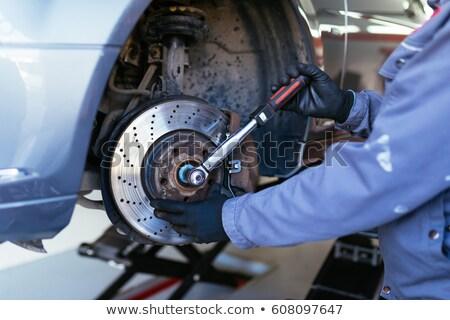 Brake repairing in garage Stock photo © smuay