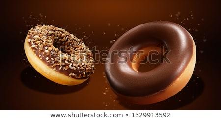Glazed donut with nuts Stock photo © Digifoodstock