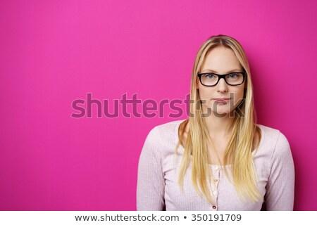 jovem · loiro · mulher · câmera · sério - foto stock © giulio_fornasar