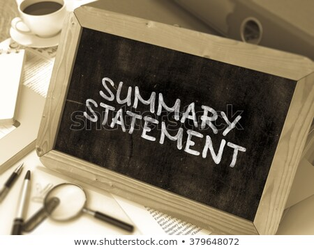Foto stock: Summary Statement Handwritten By White Chalk On A Blackboard