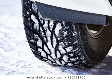 Closeup shot of automobile studded tire covered with snow at win Stock photo © Nobilior