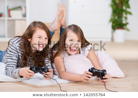 Young girl playing on a computer Stock photo © IS2