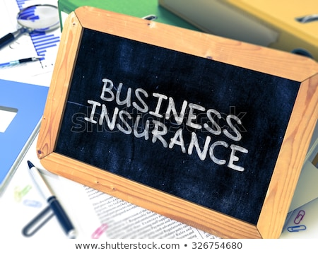 Business Insurance on Binder. Toned Image. Stock photo © tashatuvango