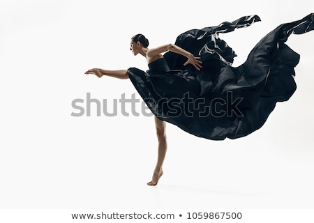 attractive young woman contemporary dancer posing on black stock photo © lightfieldstudios