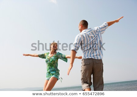 Young Couple Playing Air Plain Stock photo © IS2