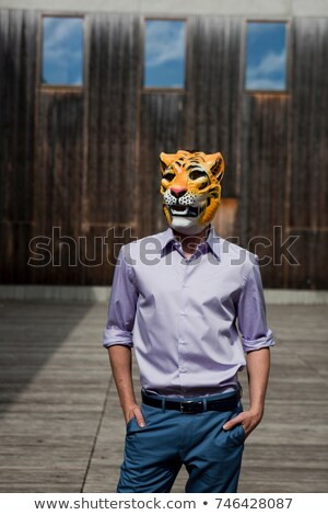man wearing tiger mask outdoor Stock photo © IS2