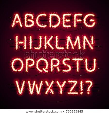 Néon rouge alphabet glitter sombre Photo stock © Voysla