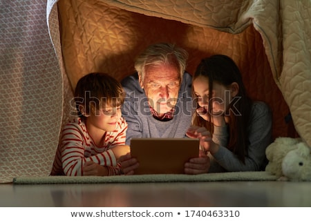 Grandfather and boy on blanket Stock photo © IS2
