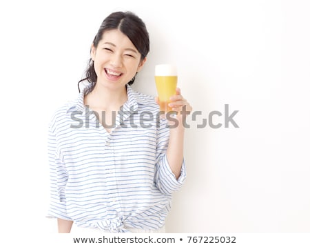 Stock photo: Woman Holding Beer