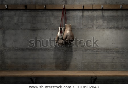 Worn Vintage Boxing Gloves Hanging In Change Room Stock photo © albund