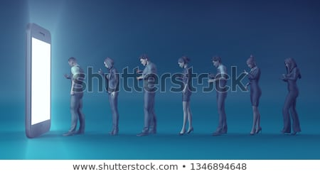 Man and woman playing on handheld device and smartphone Stock photo © IS2