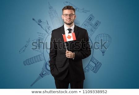 Elegante uomo giro turistico bandiera mano costruzione Foto d'archivio © ra2studio