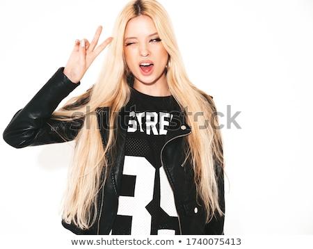 Seksi esmer siyah ceket poz duvar Stok fotoğraf © acidgrey