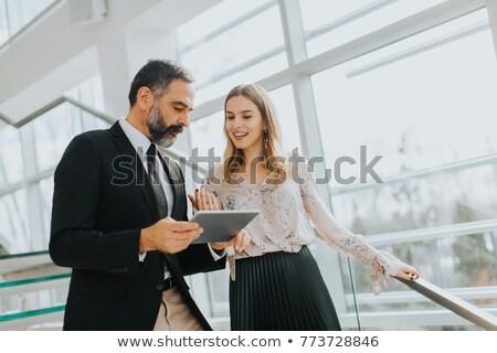 fiatal · üzletemberek · idős · kolléga · áll · iroda - stock fotó © boggy
