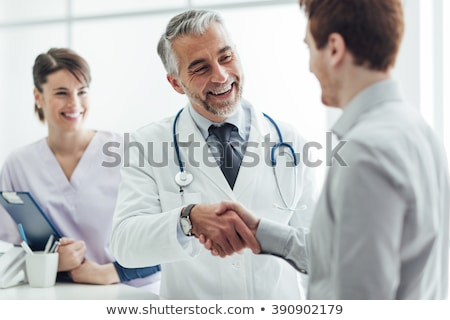 doctor at the clinic giving an handshake to his patient for enco Stock photo © snowing