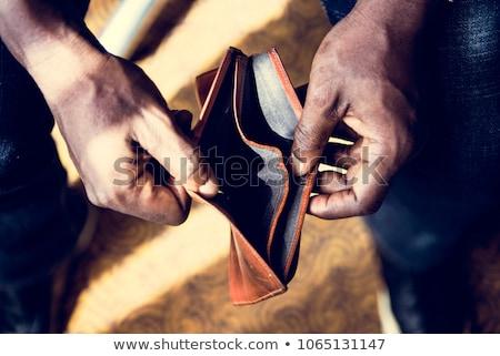 Man checking his money Stock photo © netkov1
