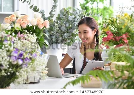 Asya kadın kız çiçek depolamak Stok fotoğraf © artfotodima
