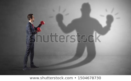 Businessman fighting with his unarmed shadow Stock photo © ra2studio