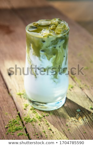 green tea latte with ice in plastic cup and straw on wooden background homemade iced matcha latte t stock photo © galitskaya