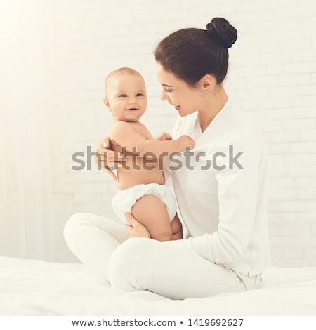 Young mother woman enjoying free time with her baby boy child Stock photo © ElenaBatkova