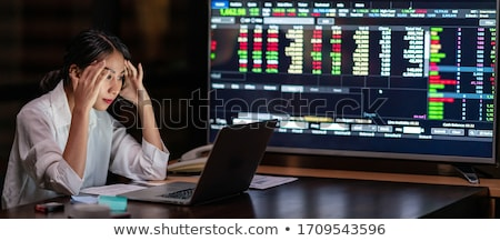 The business woman considers the data from the exchange Stock photo © ConceptCafe