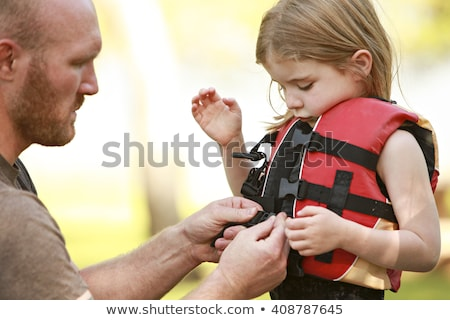 child with safety vest on the lake boat Stock photo © Lopolo
