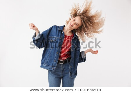Playful blonde curly woman in denim clothes having fun Stock photo © deandrobot