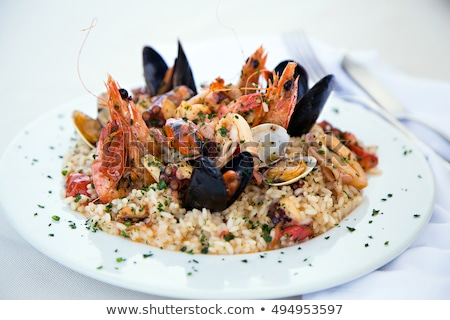 Heerlijk zeevruchten risotto parmezaanse kaas peterselie Stockfoto © karandaev