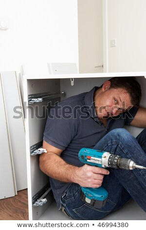 Man Trapped Whilst Assembling Flat Pack Furniture Stock photo © monkey_business