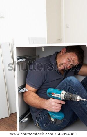 Férfi csapdába esett csomag bútor épület szerszámok Stock fotó © monkey_business