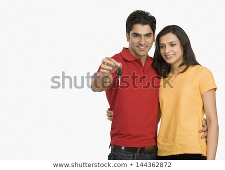 couple holding key in front of cars stock photo © wavebreak_media