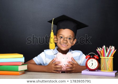 Black Graduation Hat With Piggybank On Table Stock photo © AndreyPopov