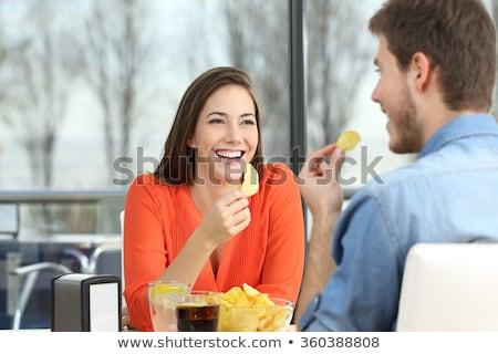 Sonriendo Pareja comer aperitivos restaurante personas Foto stock © dolgachov