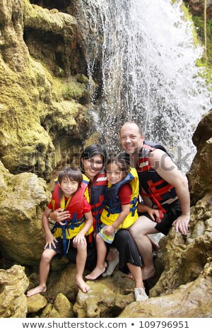 Cheerful family in waterfall area portrait Stock photo © Lopolo