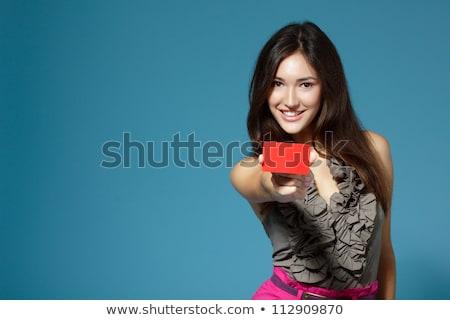 red haired teenage girl showing at something Stock photo © dolgachov