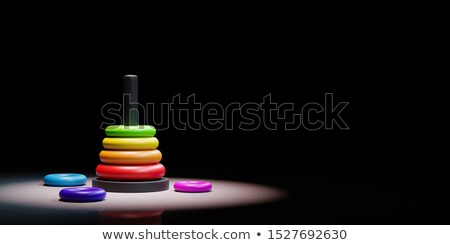 Stack of Rings Child Toy Spotlighted on Black Background Stock photo © make