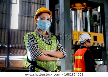 Trabajadores fabricación planta primer plano metal azul Foto stock © olira