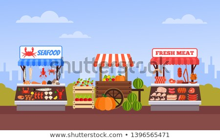 Butcher or greengrocer tanding Stock photo © lovleah
